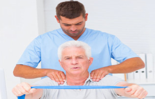 caregiver and elderly man having physical therapy