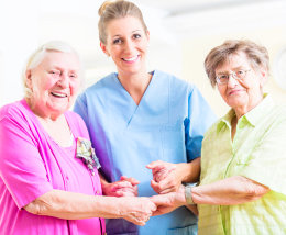 elderly women and caregiver smiling
