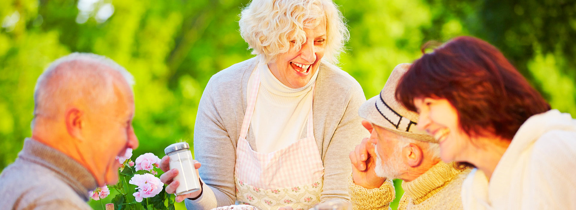 nurse and elderly group laughing
